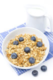 Muesli with blueberries and jug of milk isolated on white Royalty Free Stock Photos