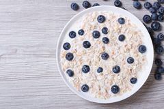 Muesli with blueberries and milk top view horizontal Stock Photos