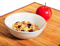 Muesli in a bowl and apple Stock Photography