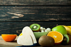 Muesli in bowl and fresh fruits with measuring tape Royalty Free Stock Photo