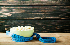 Muesli in bowl and fresh fruits with measuring tape Royalty Free Stock Photography
