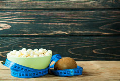Muesli in bowl and fresh fruits with measuring tape Stock Photos