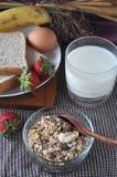 Muesli Bowl and Glass of Milk Stock Photo