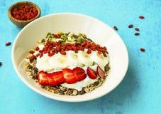 Muesli bowl with goji berries, strawberries, yogurt and banana s stock image