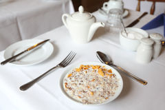 Muesli in bowl of milk on table Royalty Free Stock Image