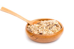 Muesli in bowl and wooden spoon Royalty Free Stock Photo