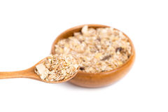 Muesli in bowl and wooden spoon Royalty Free Stock Photos