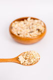Muesli in bowl and wooden spoon Stock Photo