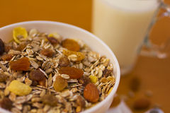 Muesli breakfast 1. Bowl of muesli and cups of milk and juice for breakfast Stock Photo