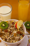 Muesli breakfast 14. Bowl of muesli and cups of milk and juice for breakfast Royalty Free Stock Photography