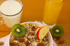 Muesli breakfast 15. Bowl of muesli and cups of milk and juice for breakfast Royalty Free Stock Photography