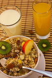 Muesli breakfast 19. Bowl of muesli and cups of milk and juice for breakfast Royalty Free Stock Photography