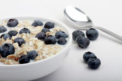 Muesli Breakfast. Muesli with milk topped with fresh blueberries Royalty Free Stock Images