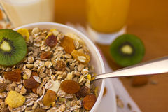 Muesli breakfast 9. Bowl of muesli and cups of milk and juice for breakfast Stock Images