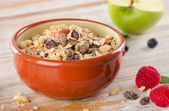 Muesli breakfast with fresh berries and green apple Stock Images