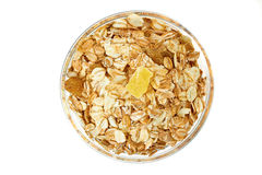 Muesli breakfast in glass bowl on white background Royalty Free Stock Photos