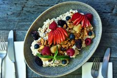 Muesli breakfast on a plate royalty free stock images