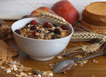 Muesli breakfast rich in fiber. Bowl of muesli with raisins and berry fruits, toast and peaches,healthy breakfast rich in fiber royalty free stock image