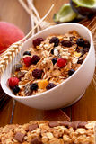 Muesli breakfast rich in fiber. Bowl of muesli with raisins and berry fruits,healthy breakfast rich in fiber royalty free stock image