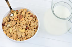Muesli in ceramic bowl and pitcher with milk Stock Photo