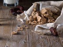 Muesli. Cereal  breakfast  healthy eating  milk  wood background  date  tes muesli Stock Photos