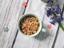 Muesli, cereal in cup. healthy breakfast scene on white wooden background. Top view photo.  Stock Image