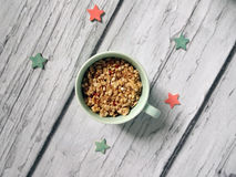 Muesli, cereal in cup. healthy breakfast scene on white wooden background. Top view photo.  Royalty Free Stock Photo