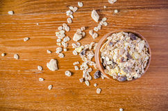 Muesli cereal grain with wooden bowl. On wooden board Stock Photos