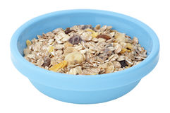 Muesli cereal in plastic bowl isolated on white Stock Images