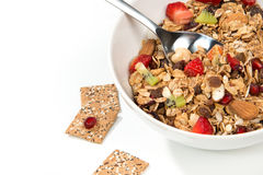 Muesli cereals bowl and spoon with almond, pine nuts, walnut, ra Stock Photos