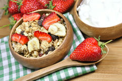 Muesli cereals, yoghurt and fresh strawberries Stock Images
