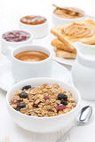 muesli, coffee, jams, toast and peanut butter for breakfast Royalty Free Stock Photos