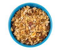 Muesli com aveia lasca-se, amendoins, passas, sementes de girassol na curva Foto de Stock