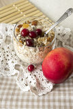 Muesli with cranberries  and apples and in a glass. Muesli in a glass with cranberries and apples   on a lace base Stock Photos