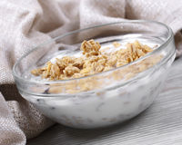 Muesli. In a cup filled in with the yogurt, healthy food Stock Photo