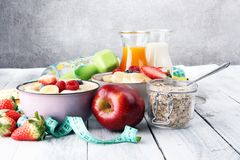 Muesli with dairy and fruit, healthy lifestyle. bowl of cereal, fruit and dumbbell.. Muesli with dairy and fruit, healthy lifestyle. bowl of cereal, fruit and Royalty Free Stock Images