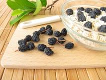 Muesli with dried aronia berries Stock Photo