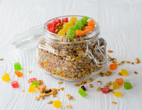 Muesli with dried fruit and candied fruit. On a white wood background, selective focus Royalty Free Stock Image