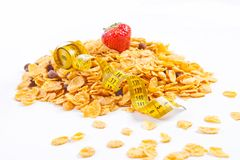 Muesli and flakes with fruites and measuring tape Royalty Free Stock Images