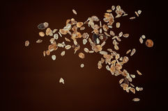 Muesli. Flying or dropping against brown background Royalty Free Stock Images