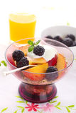 Muesli with fresh berries, fruit and yoghurt Stock Photo
