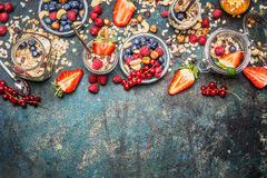 Muesli with fresh berries , nuts and seeds. Balanced breakfast ingredients on rustic background Stock Photos