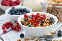 Muesli and fresh berries on white wooden background, closeup Stock Photos
