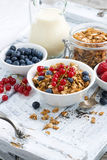 Muesli and fresh berries on white wooden background, vertical Royalty Free Stock Photos
