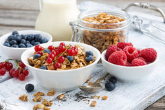 Muesli and fresh berries on white wooden table. Horizontal Royalty Free Stock Photos