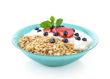 Muesli with fresh berries and yogurt in a bowl Royalty Free Stock Images
