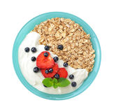 Muesli with fresh berries and yogurt in a bowl. Isolated on white background. Healthy food Stock Photos