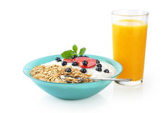 Muesli with fresh berries and yogurt in a bowl. Isolated on white background. Orange juice Stock Photos