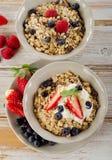 Muesli,  fresh berries and yogurt for  breakfast Royalty Free Stock Image