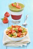 Muesli with fresh fruit and layered dessert Stock Images